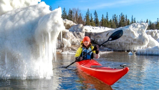 Woman winter kayaking.