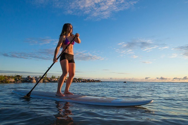 Woman paddle boarding.