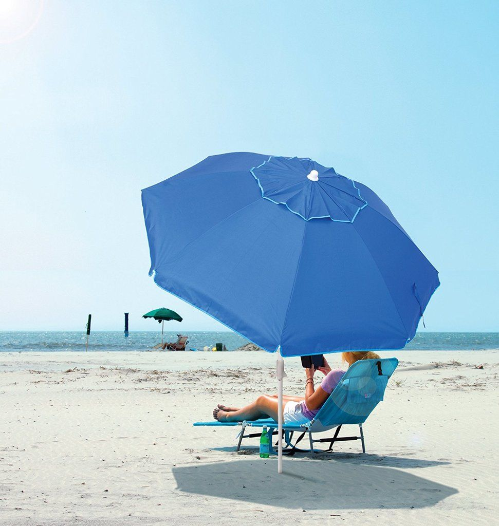 A beach umbrella with integrated sand anchor